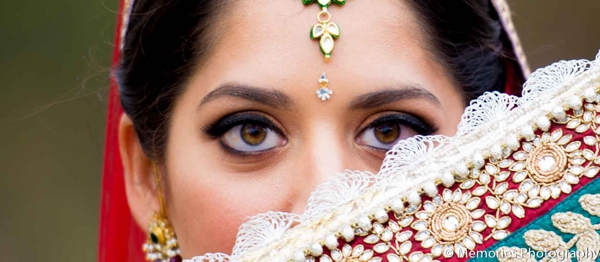 Featured Indian Weddings,red,gold,bridal jewelry,Hair & Makeup,portraits,bridal hair and makeup,bride getting ready for ceremony,inspiration for hair and makeup,ceremony tikka,Memories Photography