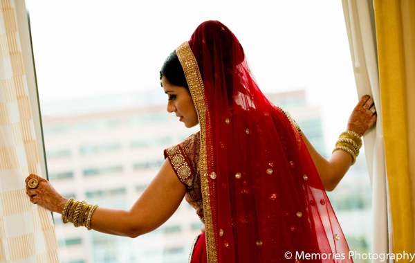 red,bridal fashions,indian bride,bridal portraits,indian bridal prep,ceremonial lengha,ceremonial veil,Memories Photography