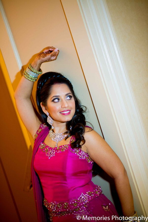 Indian wedding bride reception lengha in Bridgewater, New Jersey Indian Wedding by Memories Photography
