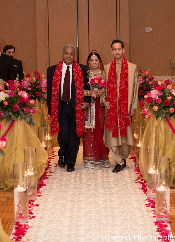 Indian wedding bride walks down aisle in Bridgewater, New Jersey Indian Wedding by Memories Photography