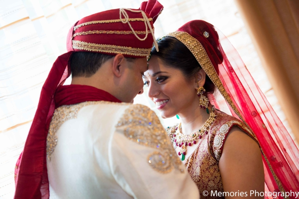 red,white,portraits,traditional sherwani,indian wedding dress,indian wedding couple,traditional lengha,couples' portraits,traditional wedding dress,Memories Photography