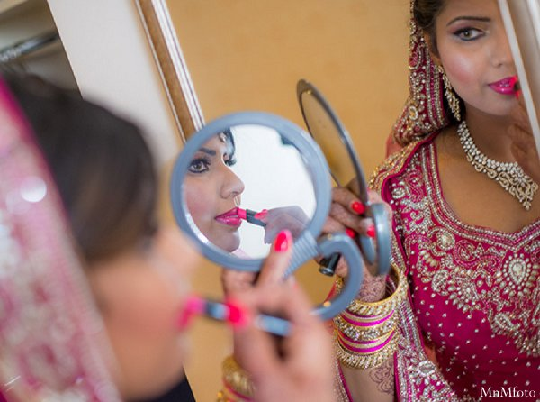 Indian wedding bride getting ready makeup in Alexandria, VA Indian Wedding by MnMfoto