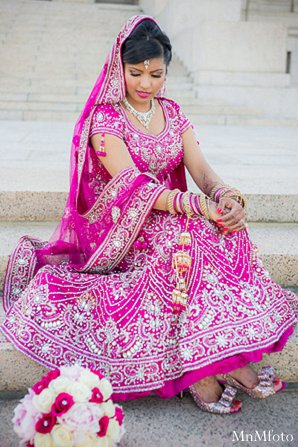 Indian wedding bride lengha pink bouquet in Alexandria, VA Indian Wedding by MnMfoto