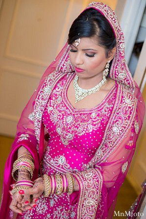 Indian wedding bride portrait lengha pink in Alexandria, VA Indian Wedding by MnMfoto