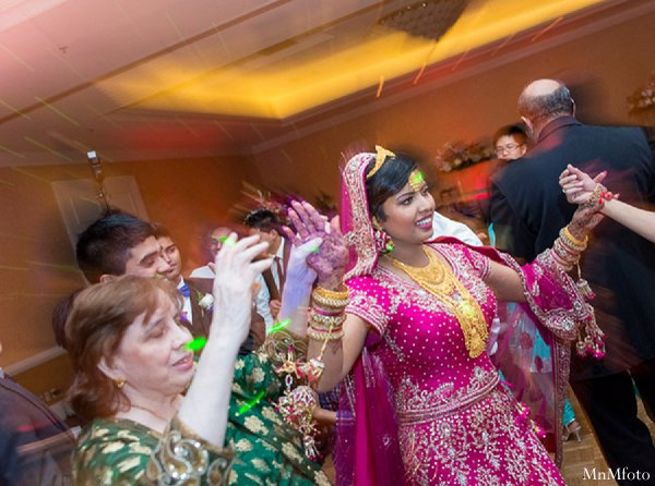 Indian wedding bride reception lengha in Alexandria, VA Indian Wedding by MnMfoto