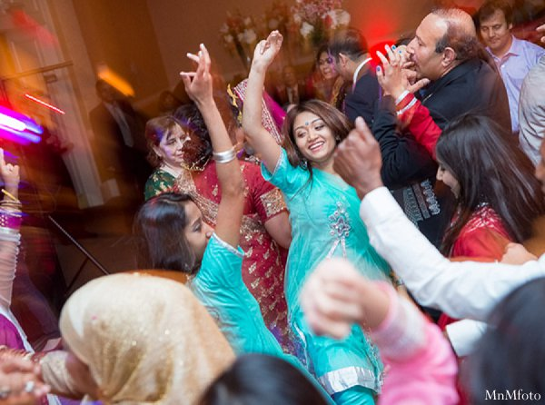 Indian wedding dancing reception guests in Alexandria, VA Indian Wedding by MnMfoto