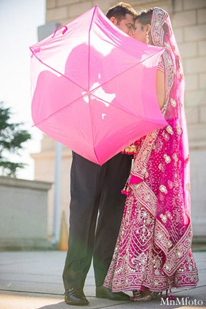 Indian wedding umbrella bride groom in Alexandria, VA Indian Wedding by MnMfoto