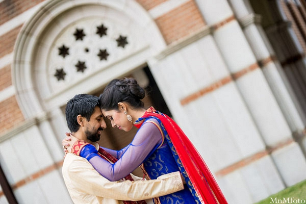 Indian wedding bride and groom outside hugging portrait in Sweethearts Sunday Winnner ~ Navneet & Koijan by MnMfoto