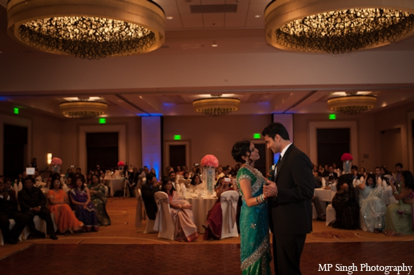 Indian-wedding-bride-groom-dancing-at-reception