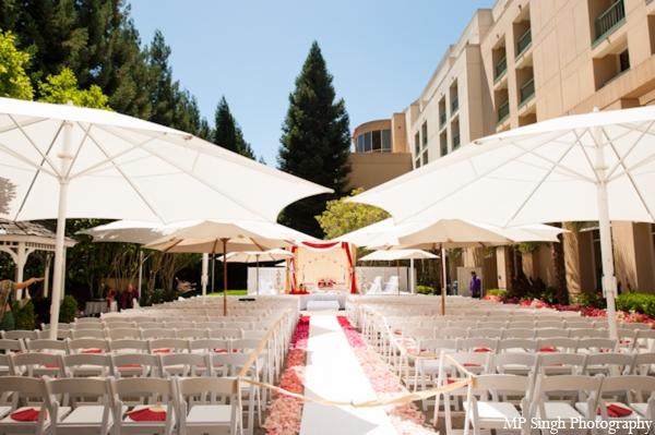 Indian-wedding-ceremony-outdoors-white-umbrellas
