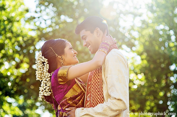An Indian bride and groom wed in a traditional Hindu wedding ceremony under a green and purple mandap. The then bride chooses a red and white lengha for her reception.