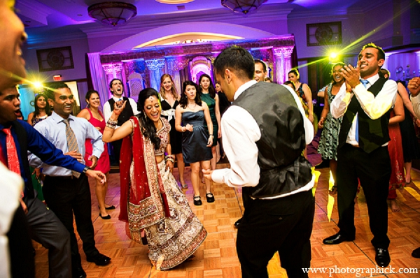 Indian wedding reception dance bride groom in Washington, DC Indian Wedding by Photographick Studios