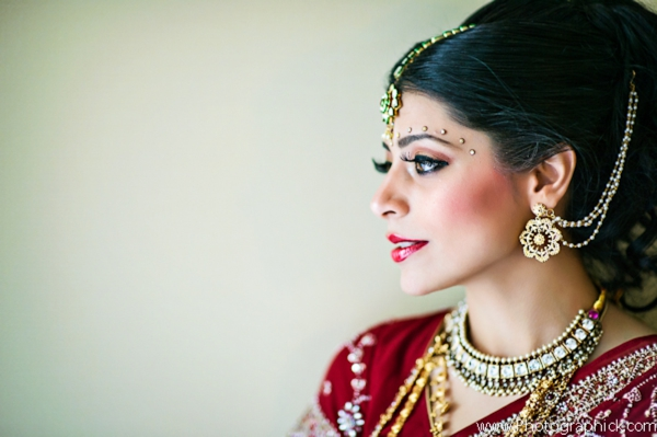 Indian-wedding-bride-getting-ready-gold-jewelry