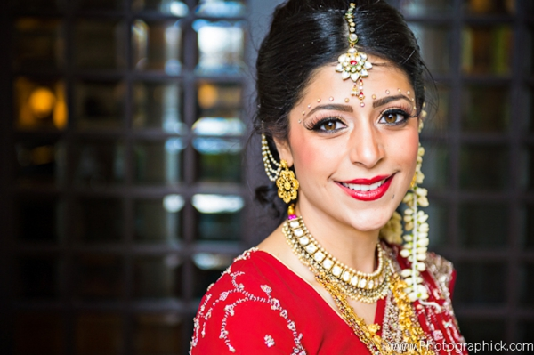 Indian-wedding-bride-red-gold-getting-ready