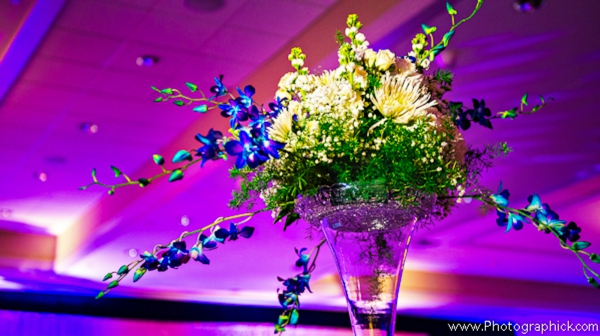 Indian-wedding-reception-purple-lighting-tall-floral