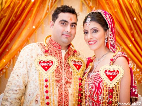 Indian wedding bride groom orange red gold