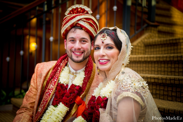red,gold,ceremony,bride and groom,indian wedding ceremony,jai mala,ceremony portraits,traditional ceremony dress,bride and groom after ceremony,after ceremony portraits