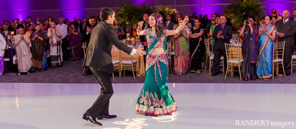 Indian wedding,purple,teal,bride and groom,reception lighting,indian wedding reception,bride and groom at reception,dance floor,bride and groom dancing,inspiration for reception design,RANDERYimagery