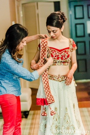 red,bridal fashions,indian bride,bridal lengha,indian wedding inspiration,RANDERYimagery,indian bride gets ready,bride gets ready for her ceremony,bridal suite photography