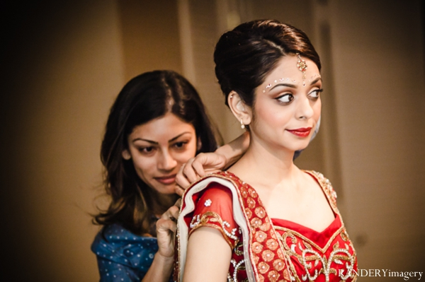 Indian wedding bride getting dressed traditional in Ontario, California Indian Wedding by RANDERYimagery