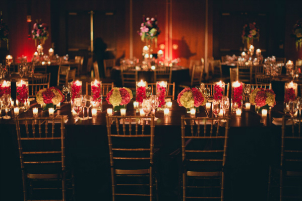 Indian-wedding-reception-tables-centerpieces-flowers-dim-lighting