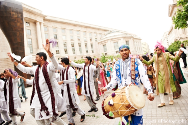 Indian wedding baraat groomsmen drummer
