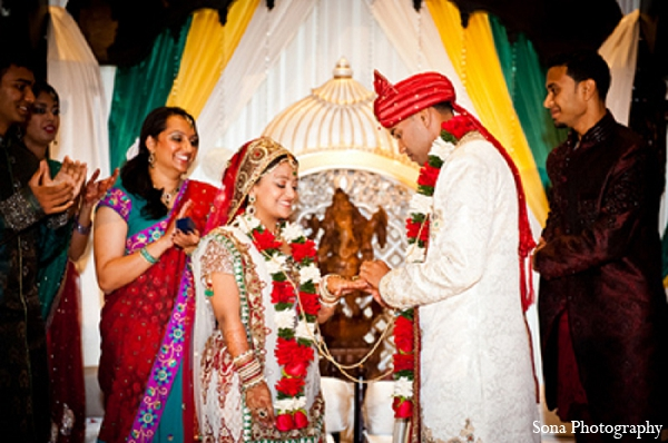Indian wedding bride groom ceremony rings in Orlando, FL Indian Wedding by Sona Photography