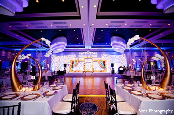 Indian wedding reception decor blue gold lighting in Orlando, FL Indian Wedding by Sona Photography