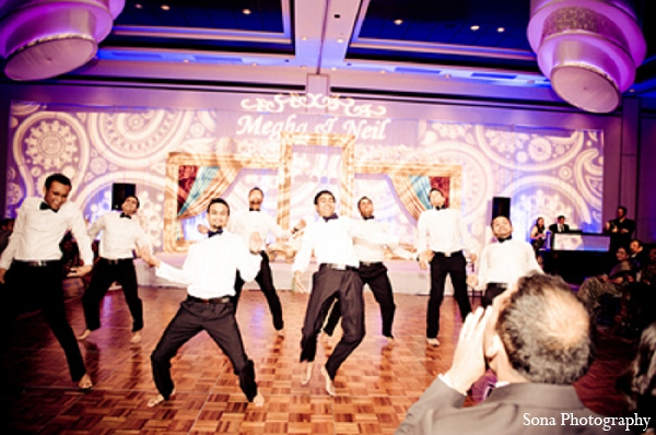 Indian wedding reception performance groomsmen lighting in Orlando, FL Indian Wedding by Sona Photography