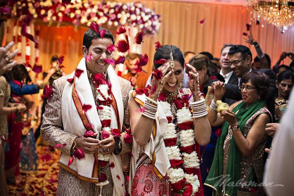 Traditonal-indian-wedding-bride-and-groom-aisle-walk