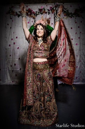 gold,maroon,bridal lengha,traditional lengha,Starlife Studios,bride at her indian reception,dancing at indian reception