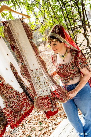 red,bridal fashions,indian wedding dress,bride getting ready,bridal portraits,traditional lengha,traditional wedding lengha,Starlife Studios