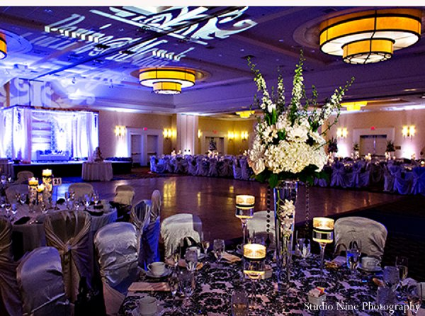 Indian wedding reception decor in Parsippany, NJ Indian Wedding by Studio Nine Photography + Cinema