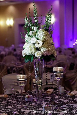 Indian wedding reception floral in Parsippany, NJ Indian Wedding by Studio Nine Photography + Cinema