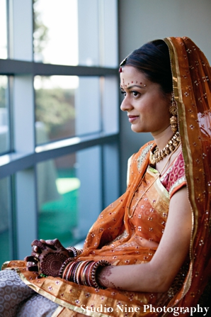 Indian-wedding-bride-sitting-by-window