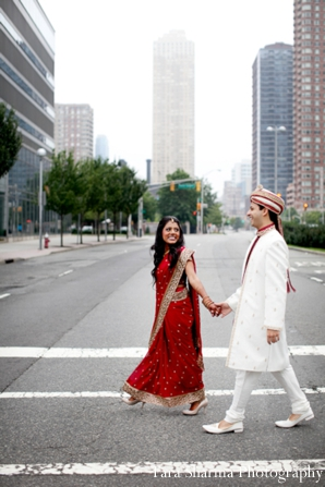 red,gold,white,bridal fashions,portraits,bride and groom,indian wedding couple,indian couple,traditional dress,couple's portrait,Tara Sharma Photography,ceremony attire