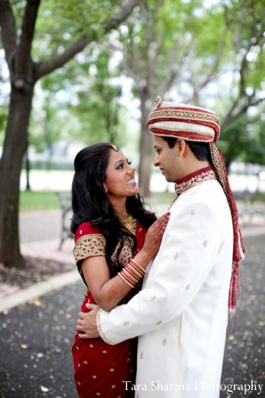 red,gold,white,portraits,bride and groom,indian wedding couple,indian couple,traditional dress,couple's portrait,Tara Sharma Photography,ceremony attire