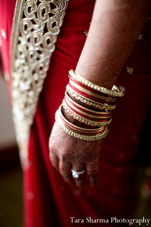 red,gold,bridal jewelry,bridal portrait,ceremony bangles,indian wedding bangles,Tara Sharma Photography,portrait of the bridal bangles