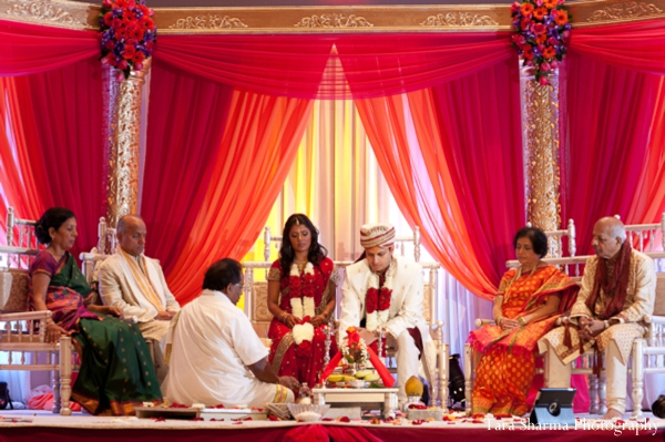 red,ceremony,mandap,indian wedding ceremony,customs and rituals,traditional wedding ceremony,ceremony traditions,fabric draped mandap,Tara Sharma Photography