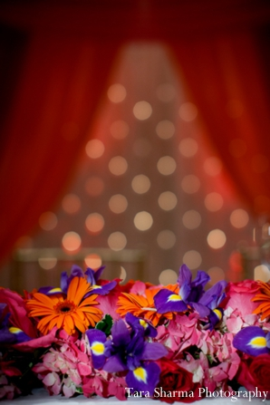 red,indian wedding lighting,inspiration for lighting,ceremony lighting,floral at ceremony,lighting ideas