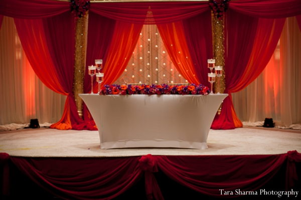 red,gold,Planning & Design,indian wedding lighting,inspiration for lighting,reception sweethearts table,ceremony lighting,Tara Sharma Photography,floral at ceremony,lighting ideas,sweetheart table