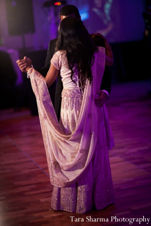 purple,reception lighting,indian wedding reception,dance floor lighting,wedding reception dance,Tara Sharma Photography,bride dances at wedding reception,bridal gown reception gown inspiration