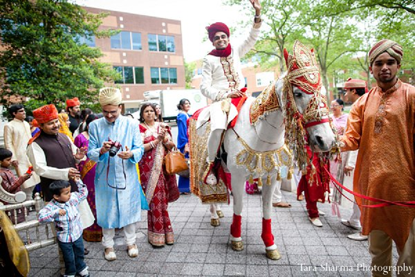 Indian-wedding-baraat-groom-horseback in Princeton, NJ Indian Wedding by Tara Sharma Photography