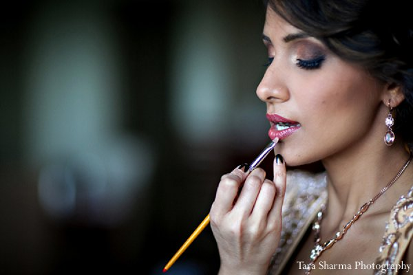 Indian wedding bride getting ready makeup in Princeton, NJ Indian Wedding by Tara Sharma Photography