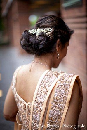 Indian wedding bride lengha reception peach in Princeton, NJ Indian Wedding by Tara Sharma Photography