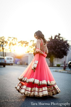 Indian wedding bride sangeet lengha pink in Princeton, NJ Indian Wedding by Tara Sharma Photography