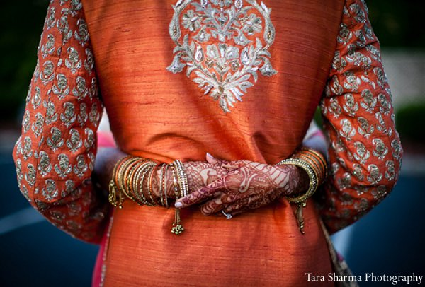 Indian wedding bride sangeet orange bridal fashions in Princeton, NJ Indian Wedding by Tara Sharma Photography