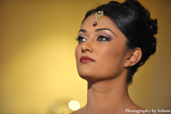 Indian-wedding-bride-getting-ready-makeup-tikka-gold