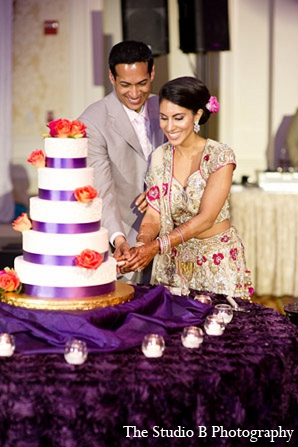 Indian wedding cake bride groom in Durham, North Carolina Indian Wedding by The Studio B Photography
