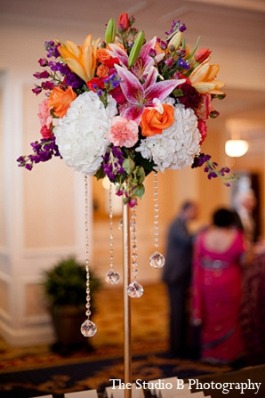 Indian wedding reception floral decor arrangments in Durham, North Carolina Indian Wedding by The Studio B Photography